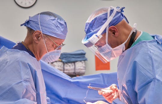 Drs. A.D. and A.J. Brickler perform A.D.'s last C-section birth together at Tallahassee Memorial Hospital Friday, Feb. 1, 2019.