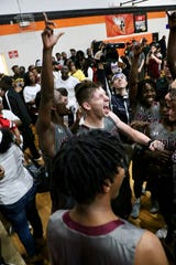 Dilan Lawson screams as Madison County's boys basketball team won a hard-fought game at state No. 1 Hawthorne to reach its second straight Class 1A state tournament.