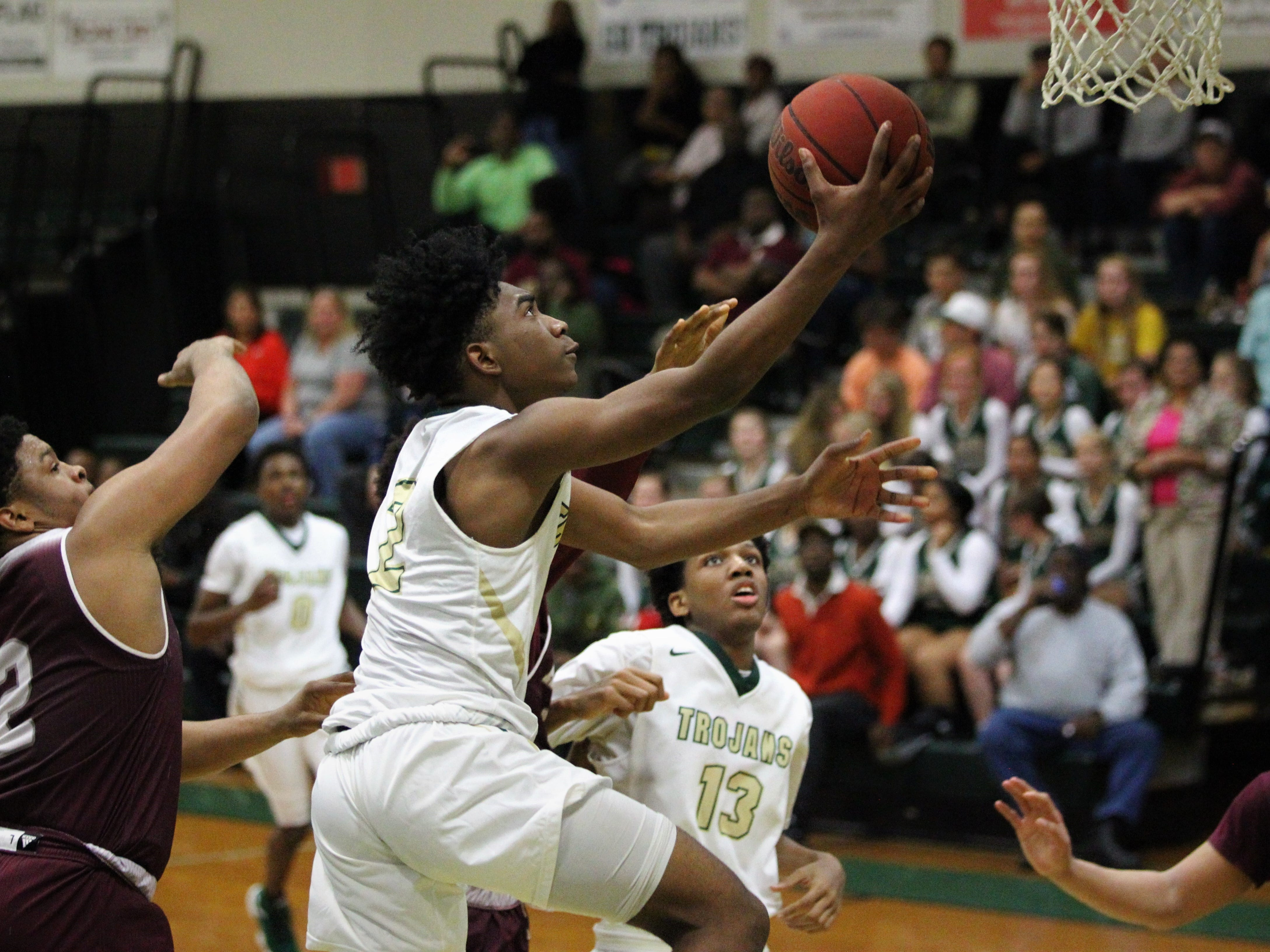 Lincoln's Zae Wiggins drives for a layup as the Trojans beat Tate 74-41 in a Region 1-8A semifinal on Feb. 26, 2019.