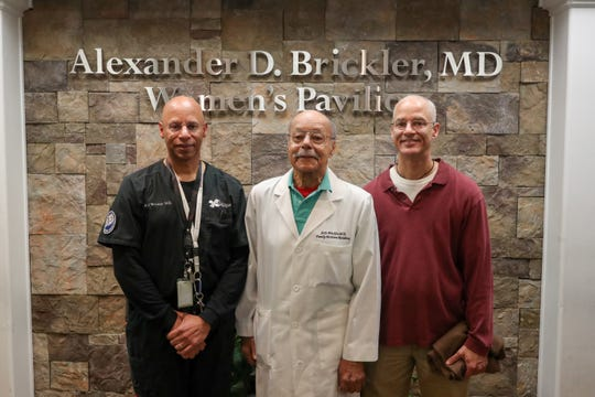 Dr. A.J. Brickler, Dr. A.D. Brickler and Michael Brickler pose for a photo in the A.D. Brickler Women's Pavilion named after the eldest doctor, 90, who is retiring from Tallahassee Memorial Hospital.