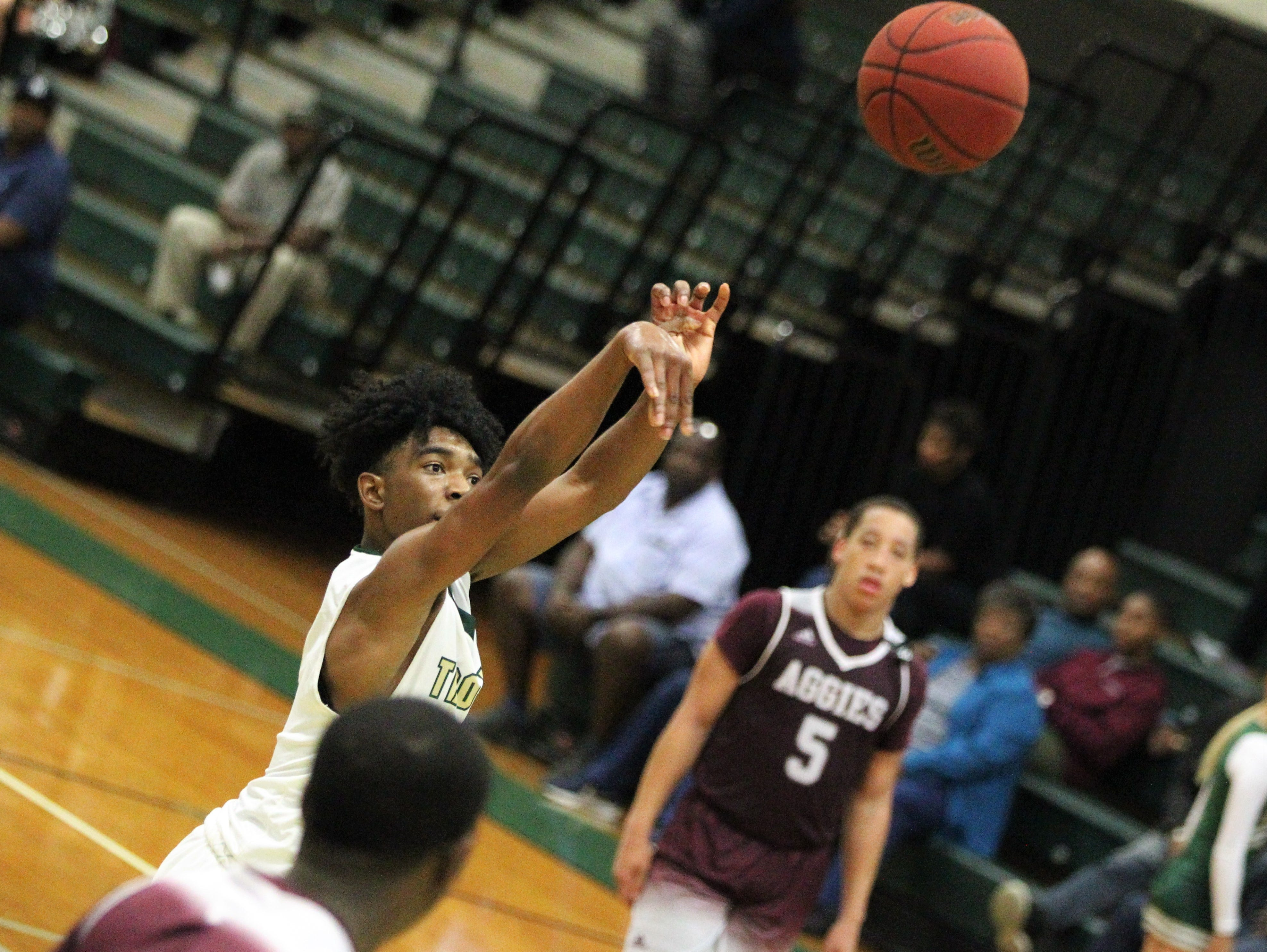 Lincoln's Zae Wiggins shoots a free throw as the Trojans beat Tate 74-41 in a Region 1-8A semifinal on Feb. 26, 2019.