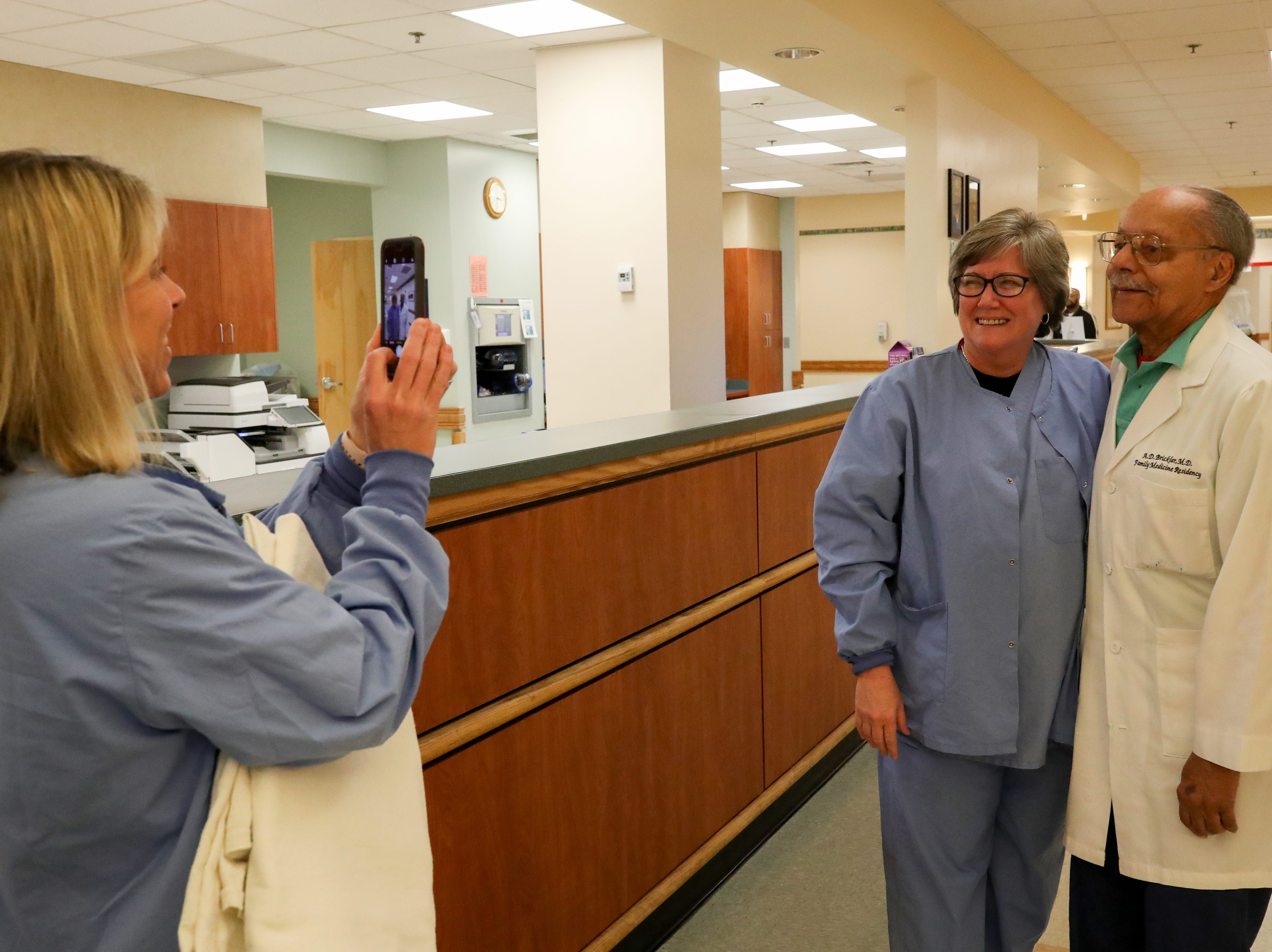Registered Nurse Terrie Hutto asks to have her photo taken with Dr. A.D. Brickler, 90, who is retiring from Tallahassee Memorial Hospital where he is estimated to have delivered over 30,000 babies.