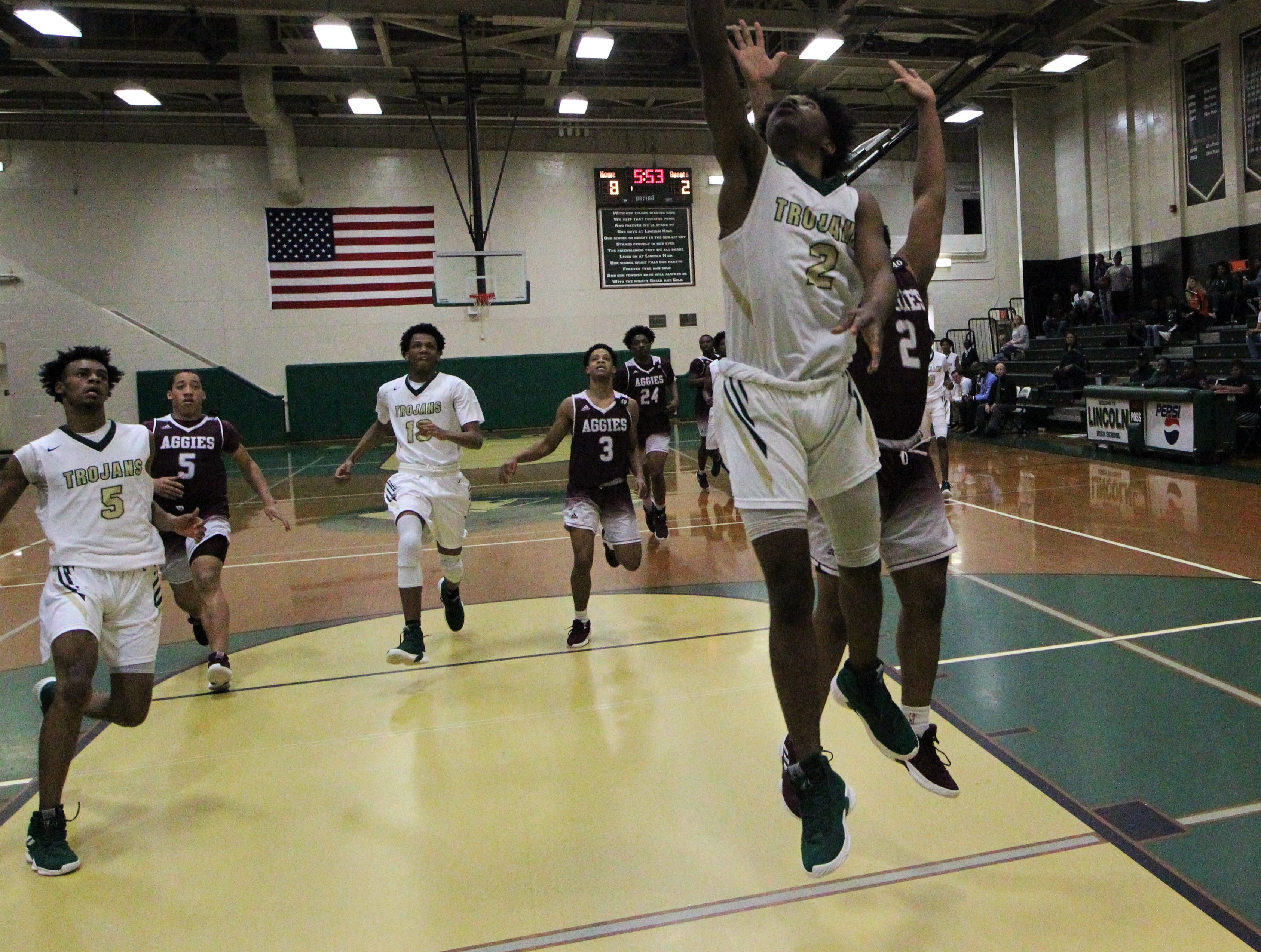 Lincoln's Zae Wiggins drives for a fastbreak layup as the Trojans beat Tate 74-41 in a Region 1-8A semifinal on Feb. 26, 2019.