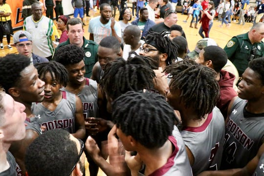 Madison County's boys basketball team won a hard-fought game at state No. 1 Hawthorne to reach its second straight Class 1A state tournament.
