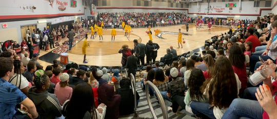 Franklin County's gym was packed to the brim for its Region 2-1A final against rival Port St. Joe. The Seahawks' boys basketball team won in overtime to advance to the Class 1A state tournament.