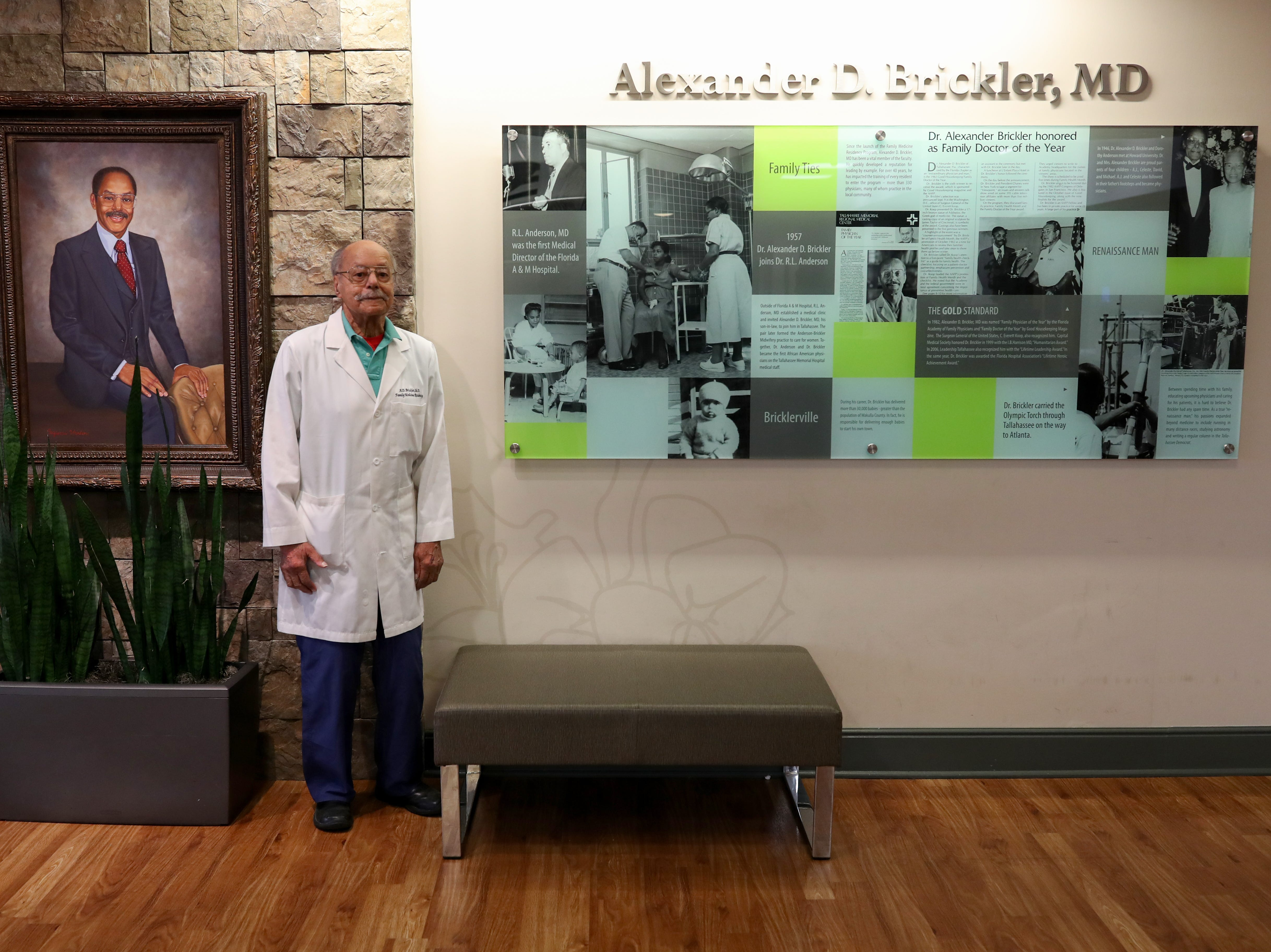 Dr. A.D. Brickler poses for a photo in front of a wall that honors his legacy in the Tallahassee Memorial Hospital Women's Pavilion that is named after him Wednesday, Feb. 27, 2019.