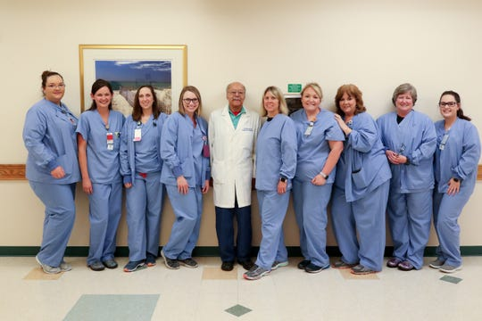 Labor and delivery nurses pose for a photo with Dr. A.D. Brickler in the Women's Pavilion at Tallahassee Memorial Hospital Wednesday, Feb. 27, 2019.
