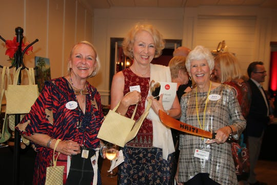 """Roz Allen, left, Tonia Deary and Jean Cravensat the Haiti Partners' """"Educate and Celebrate"""" event at Grand Harbor Golf Club."""