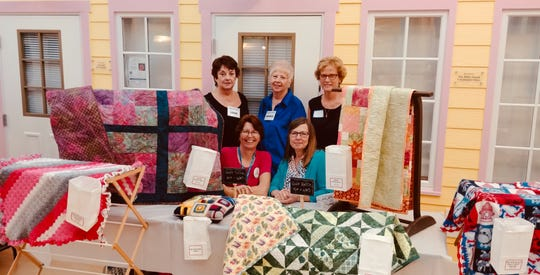 Project Linus members, from left, standing, Lana Stewart, Monica Rodriguez and Melissa King; seated, Karen Goforth and Barb Ruzicka.