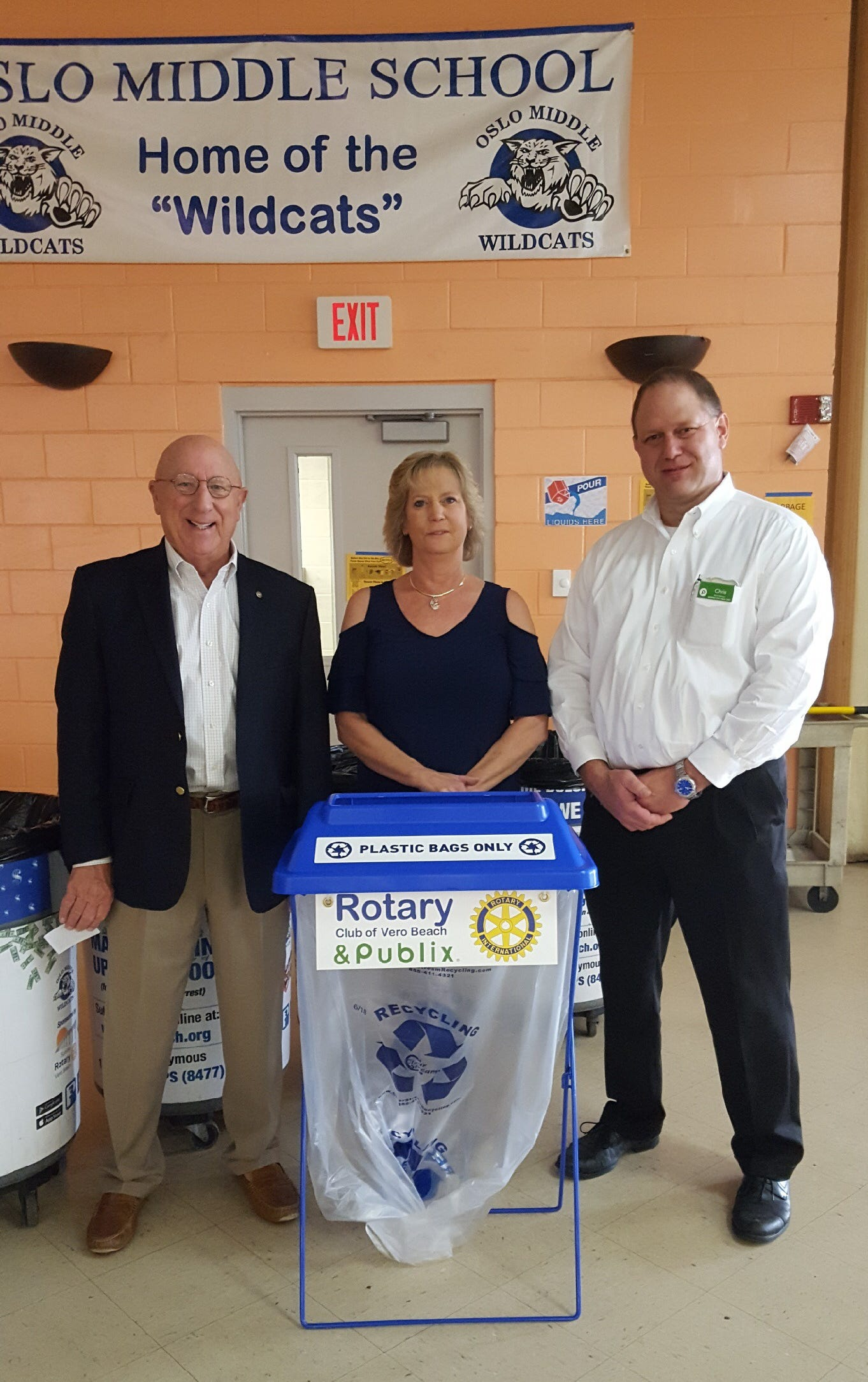Dan Compas (from left), Rotary Club of Vero Beach; Ann Rieben, Indian River County School District custodial services coordinator; Chris Ellis, Publix store manager