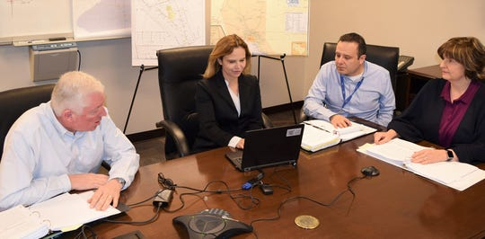 Mary Kipp, El Paso Electric CEO, center, talks to Wall Street analysts on a conference call Feb. 27 to discuss the company's year-end earnings report. Also on the call are Nathan Hirschi, company chief financial officer, left, Adrian Rodriguez,  general counsel, and Lisa Budtke, director of investor relations.