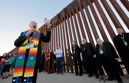 Hope Border Institute and the Diocese of El Paso Commission on Migration held a border prayer vigil at the border fence in Anapra Tuesday. Clergy from El Paso, Juarez and New Mexico gathered to pray for migrants and improved immigration policy. Bishop Mark Seitz of El Paso held photos of two children who died in U.S. custody and prayed it would never happen again.