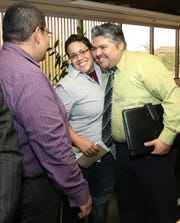 08/26/2009 Raul Martinez, from left, Cristina Rivera and Cesar Campa, members of Puentes, LGBT Resources, celebrate the City Council's vote to extend health-insurance benefits to gay and unmarried heterosexual partners of city employees. More than 40 people spoke for and against the proposal at Tuesday's meeting of the City Council, sometimes in very heated language.
