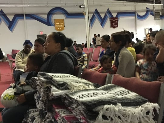 Immigrants rest at Caminos de Vida church on Tuesday, Feb. 26, 2019, after they were dropped off there by Immigration and Customs Enforcement.