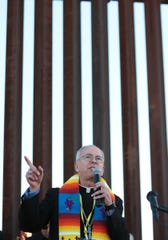 Bishop Mark Seitz and others participated in a border prayer vigil at the border fence in Anapra in February of this year.