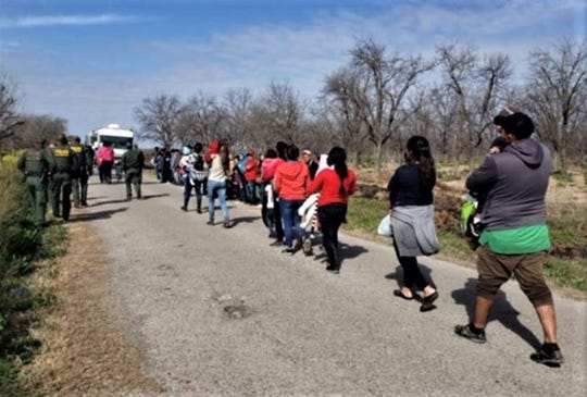A group of 90 Honduran migrants surrendered to the U.S. Border Patrol in the small town of Quemado, Texas, northwest of Eagle Pass, on Monday, Feb. 25, 2019.