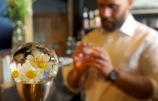 At Oak & Iron in Thousand Oaks, locally foraged flowers are embedded in specialty ice cubes made by head bartender Paul Jones.