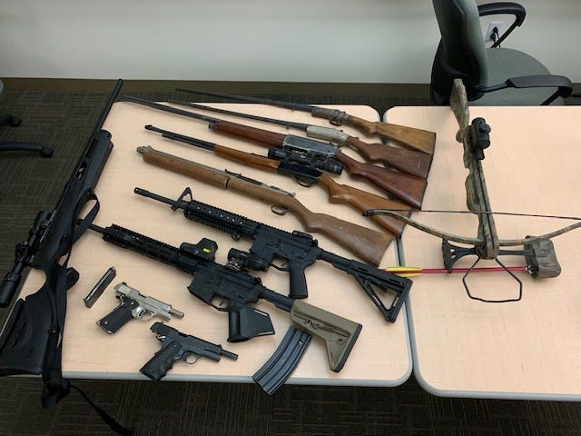 Weapons seized during a search warrant served in Moorpark at the residence of a suspect banned from possessing firearms.