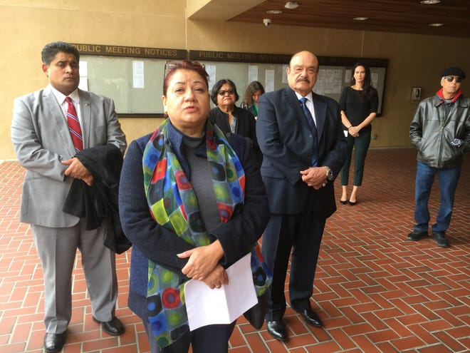 Martha Navarrete, of Santa Clara Valley Hospice in Santa Paula, Roberto Juarez (right) and others pledged their support for a two-plan Medi-Cal system in Ventura County at a February news conference.