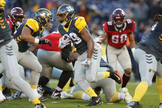San Diego Fleet running back Terrell Watson finds some room to run during Sunday's AAF game against the San Antonio Commanders. The Oxnard High graduate rushed for 73 yards and a pair of two-point conversions.