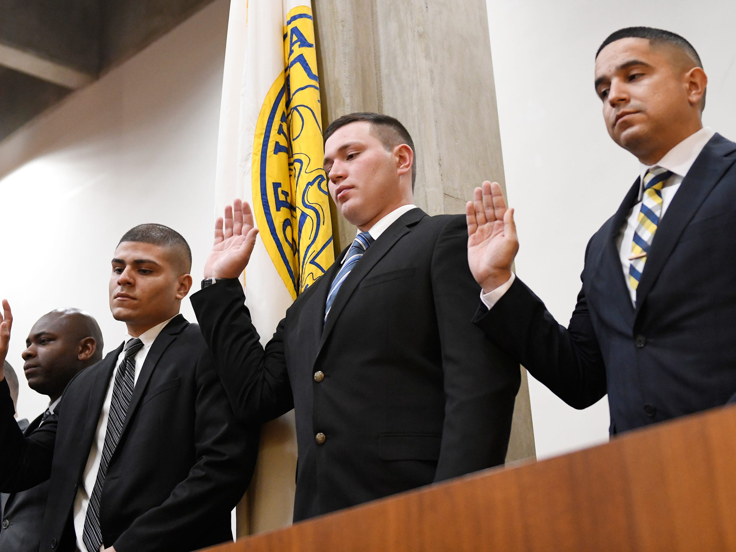 Mayor Anthony Fanucci swore in eight police officers at Vineland City Hall on Wednesday, Feb.27, 2019. (From l to r) Pictured here are Teyson M. Mayes, Isaiah Rosa, Christopher Yuhas and Edmanuel Vega.