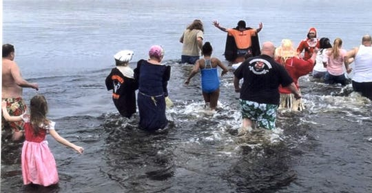 Seventeen participants were brave enough to participate in this year's Snowflake Plunge in Millville.