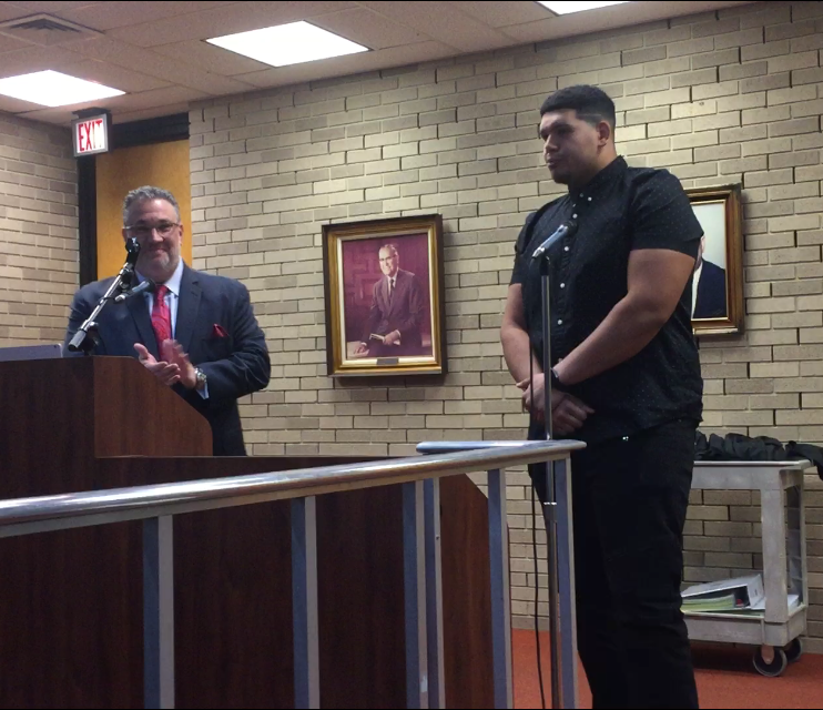 National Football League lineman Jamil Demby (right) was honored at Tuesday night's Vineland City Council meeting. Mayor Anthony Fanucci (left) congratulated Demby for his success.