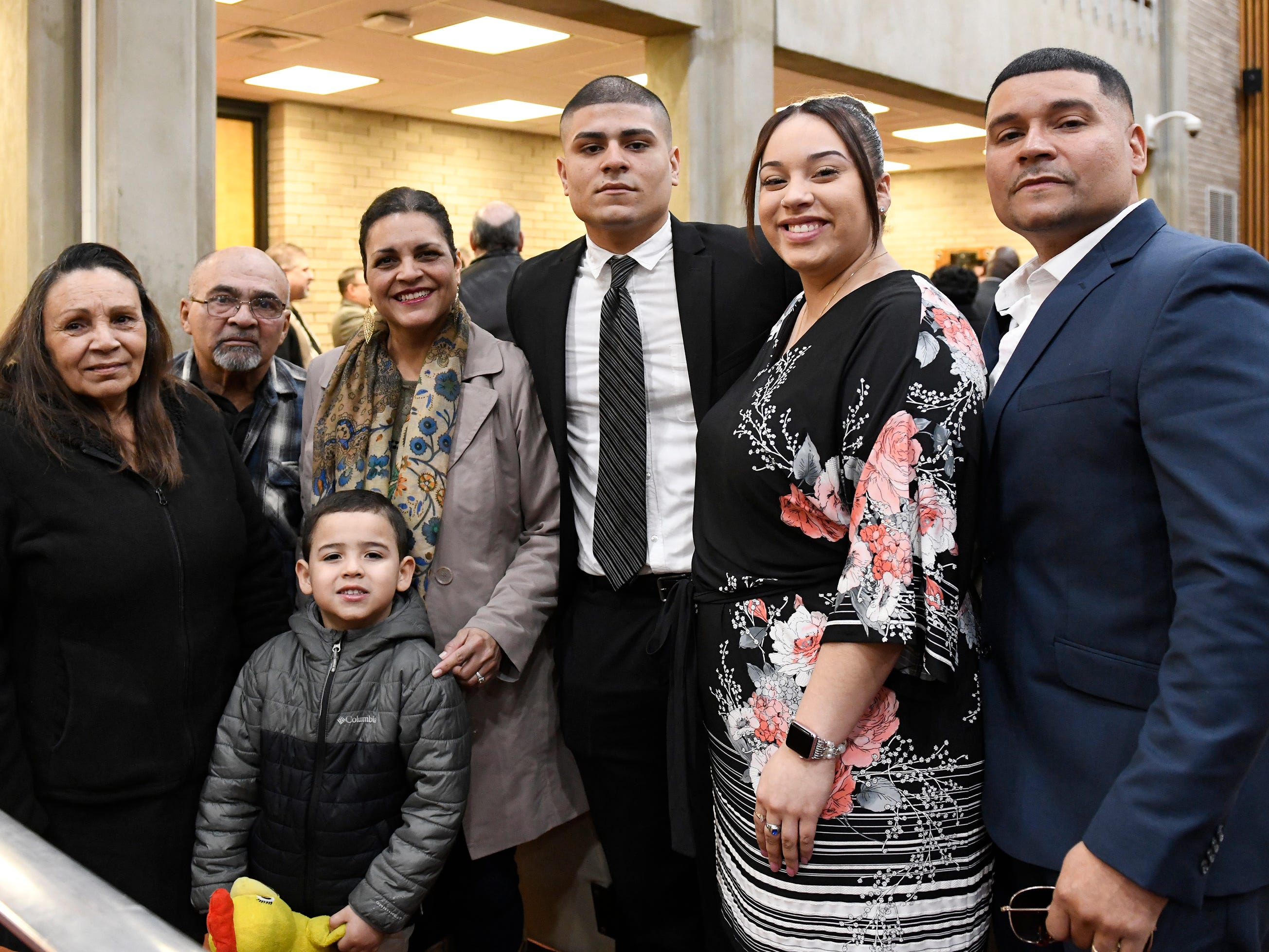 Isaiah Rosa (center) stands with his family after being sworn in as a police officer by Mayor Anthony Fanucci at Vineland City Hall on Wednesday, Feb.27, 2019.