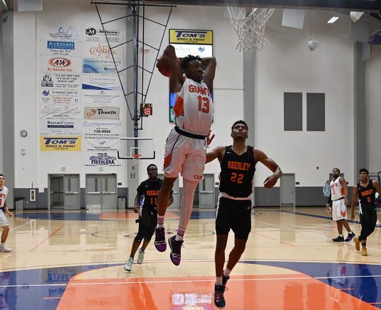 COS' T.J. Givance  goes up for a dunk earlier this season.