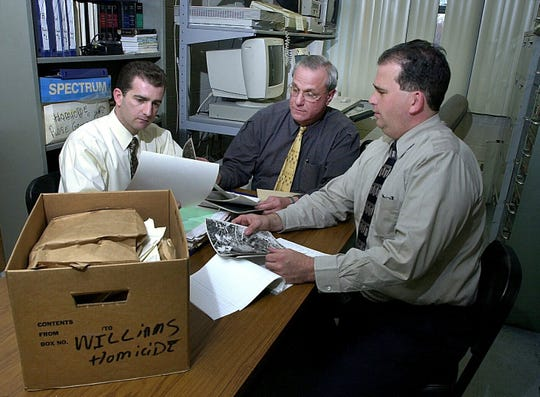 -  -Greenburgh Police Detectives Dennis DiMele (left) and Richard Cunningham (right), here with Captain Joseph P. Delio comprised the department's Cold-Case Squad in 2002, when they reopened the investigation into Stacey Boothe-Wilson's 1994 disappearance.