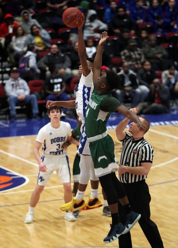 Woodlands' Noe Fleurimond and Dobbs Ferry's Dimaunie Meredith compete for a jump ball during Dobbs Ferry's 67-55 victory in the Class B semifinals at the Westchester County Center on Feb. 26, 2019. Both players were named all-state.