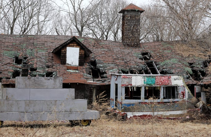 An old parade float sits in front of dilapidated barn structures are pictured at Ward Acres Park in New Rochelle, Feb. 27, 2019.