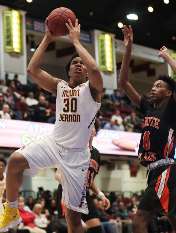 Mt. Vernon's Troy Hupstead (30) goes up for a shot in front of White Plains' Quion Burns (0) during the boys Class AA basketball semifinal at the Westchester County Center in White Plains  Feb. 27,  2019. Mt. Vernon won the game 62-48.