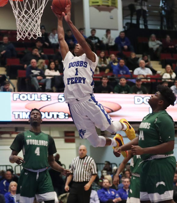 Dobbs Ferry's Dimaunie Meredith (1) drives to the basket against Woodlands in the Class B semifinal at the Westchester County Center in White Plains  Feb. 26,  2019. Dobbs Ferry won the game 67-55.