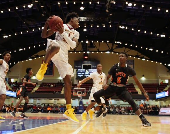 Mt. Vernon's Irvin Patrick (1) pulls down a rebound in front of White Plains' Jayon Norwood (5) during the boys Class AA basketball semifinal at the Westchester County Center in White Plains  Feb. 27,  2019. Mt. Vernon won the game 62-48.
