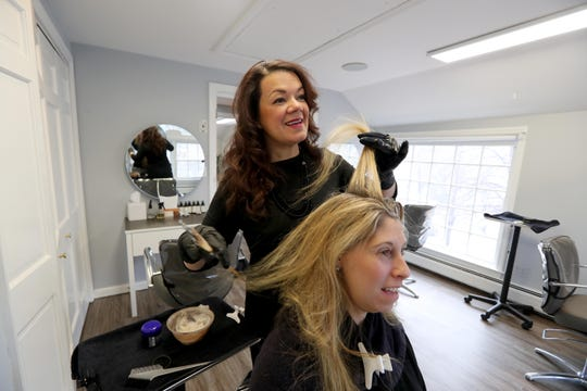 Leticia Villagran, owner of Aura Salon in Chappaqua, colors the hair of client Lisa Shaiken of Chappaqua Feb. 27, 2019. Villagran has utilized the services of The Acceleration Project to help improve her business.
