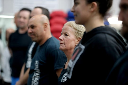 Elizabeth Murphy of Valhalla at the start of a self-defense class at Steve Sohn's Krav Maga Self-Defense and Training Center in Scarsdale.
