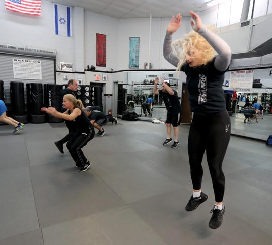 Elizabeth Murphy of Valhalla, left, and Valentina Kocovic of Bronxville warm up at the start of a self-defense class at Steve Sohn's Krav Maga Self-Defense and Training Center in Scarsdale Feb. 26, 2019. Krav Maga is a military self-defense and fighting system developed for the Israel Defense Forces.