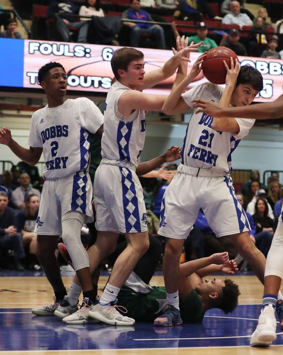 Dobbs Ferry's Luke Distefano (21) pulls down a rebound against Woodlands during the Class B semifinal at the Westchester County Center in White Plains  Feb. 26,  2019. Dobbs Ferry won the game 67-55.