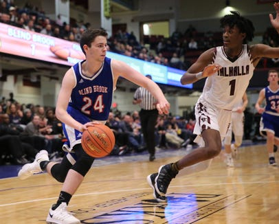 Blind Brook's Gilad Price (24) works the baseline against Valhalla's Marlin Wise (1) during the boys class B semifinal game at the Westchester County Center in White Plains on Tuesday, February 26, 2019.
