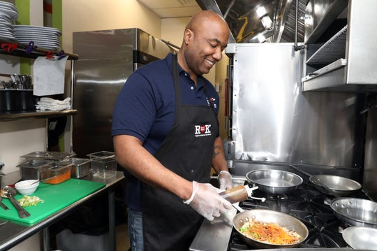 Owner and chef Rocky Alexander makes cauliflower fried rice at Rock's Kitchen in Stony Point Feb. 27, 2019. The new fast casual healthy eatery was inspired by Alexander's healthy lifestyle after undergoing bariatric surgery.