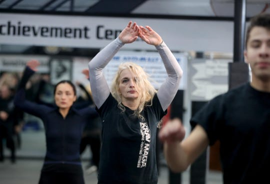 """Valentina Kocovic of Bronxville works out at Steve Sohn's Krav Maga Self-Defense and Training Center in Scarsdale Feb. 26, 2019. """"I have more awareness of my surroundings, more self-confidence; I feel safer,"""" says  Kocovic."""
