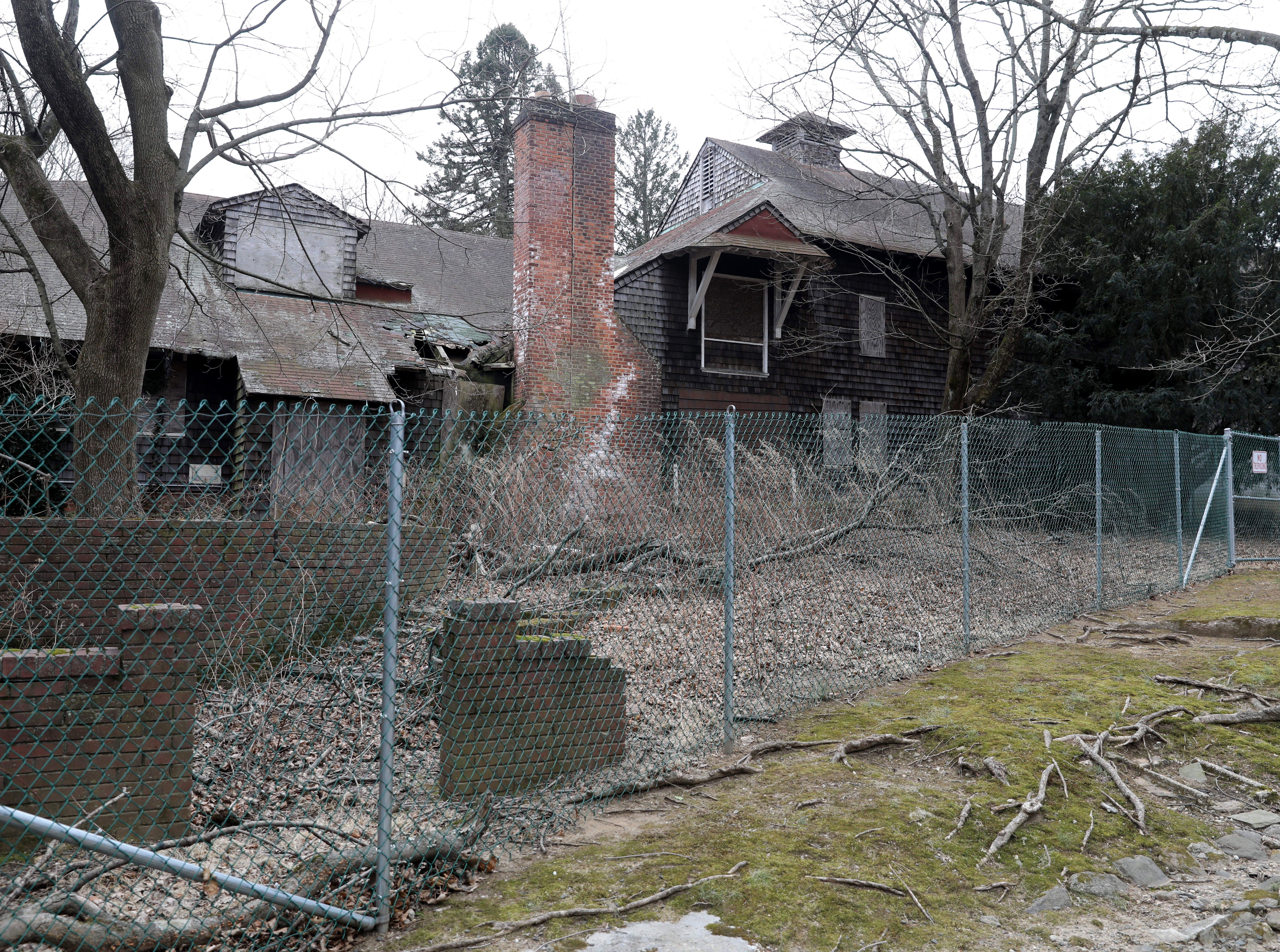 Fencing surrounds dilapidated barn structures at Ward Acres Park in New Rochelle, Feb. 27, 2019.