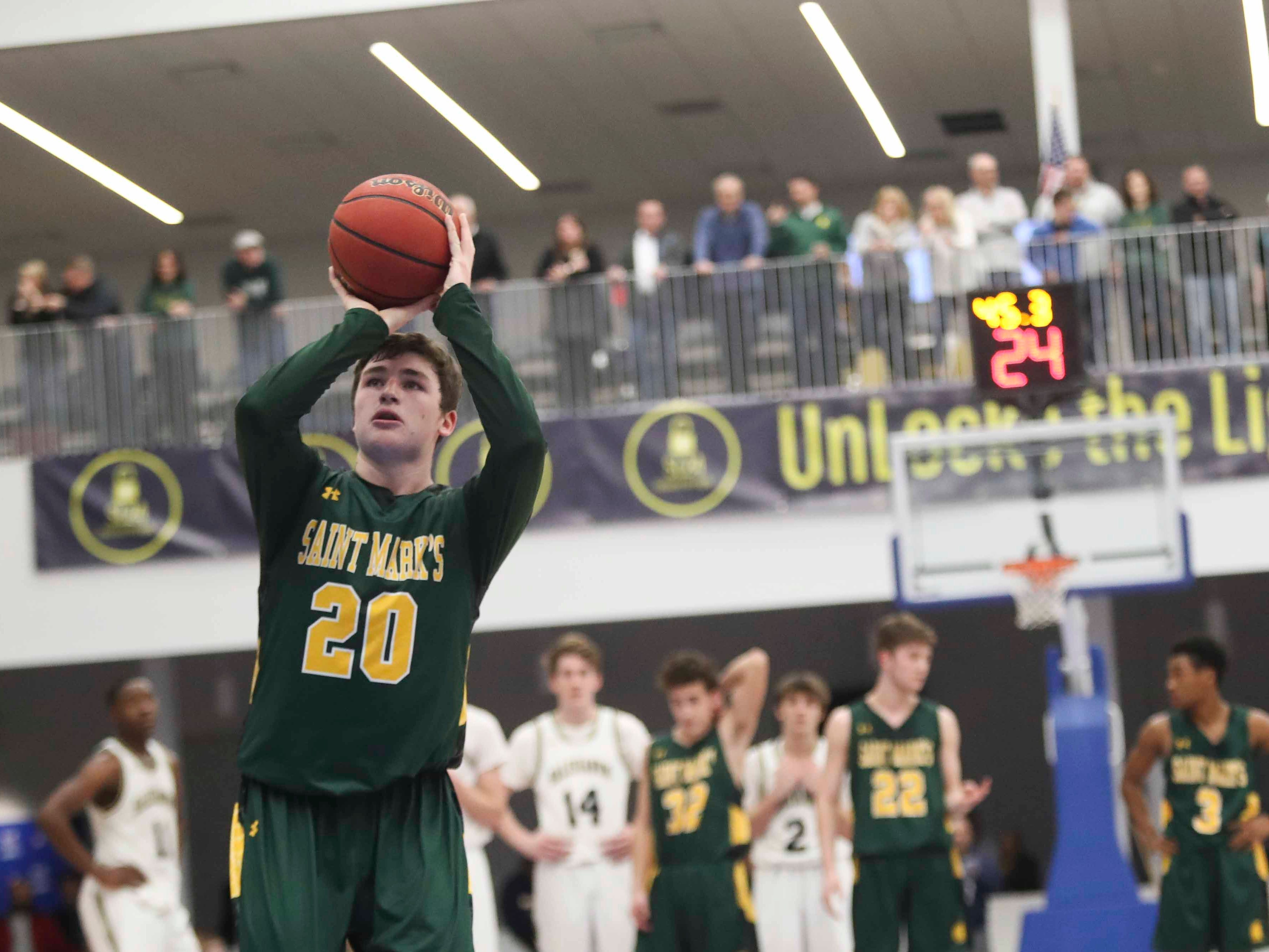 St. Mark's Eric Ludman lines up a free throw in front of a shot clock at the 76ers Fieldhouse in Wilmington Friday. The clocks were not being used in this game, the SL24 Memorial Basketball Classic in early February.