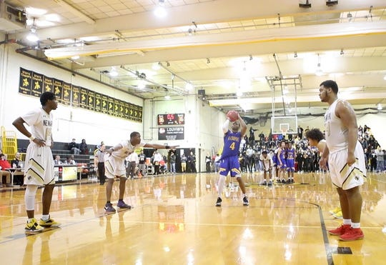 A.I. duPont's Jamir Dantley (4) shoots his game winning free throw against Newark with less than one second on the clock Tuesday night. A.I. duPont defeated Newark 37-36.