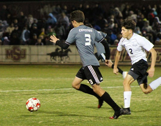 Taylor Davis strides toward the ball for Old High against Rider's Adam Canales. The Coyotes defeated the Raiders 5-3 in penalty kicks.