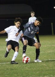 Old High's Alonso Cerna shields the ball from Rider's Eduardo Cerna in their match Tuesday, February 26, 2019, at MSU's soccer field.