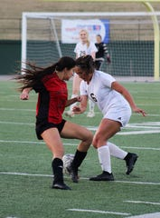 Old High's Lupe Lugo contests Rider's Gabby Garcia for the ball. Rider defeated Old High 2-0 on February 26, 2019 at Memorial Stadium.