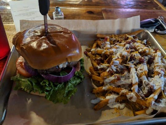 Kimchi bacon burger and cheddar bacon ranch fries at Gyspy Uncorked.