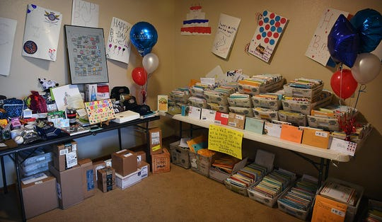 A separate room is being used to store the gifts, posters, balloons and approximately 16,000 birthday cards received for World War II veteran Joe Cuba at Brookdale Senior Living. Cuba's family requested on social media for him to receive 100 cards for his 100th birthday and was interviewed on the Today Show and Good Morning America.